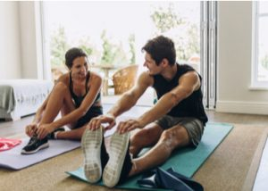 a couple doing a full body workout at home