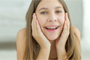 girl wearing traditional braces