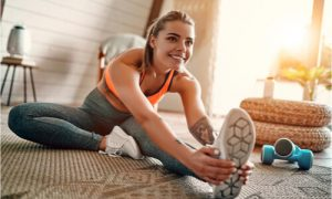The woman stretches her body before proceeding to his regular exercise.