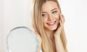smiling in front of mirror